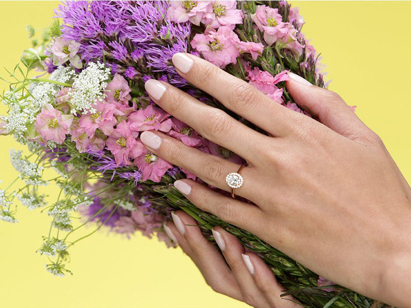 woman with painted nails holding a wedding bouqet