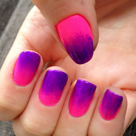 Ombre nails using summer nail colors: pink and purple