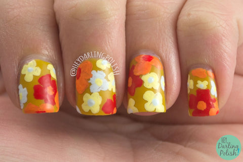 Retro nail art featuring a floral design with summer nail polish colors