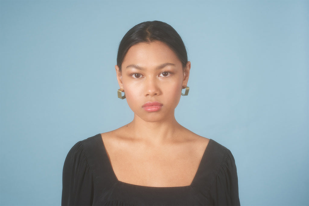 Model wearing Wide Square Hoops Small