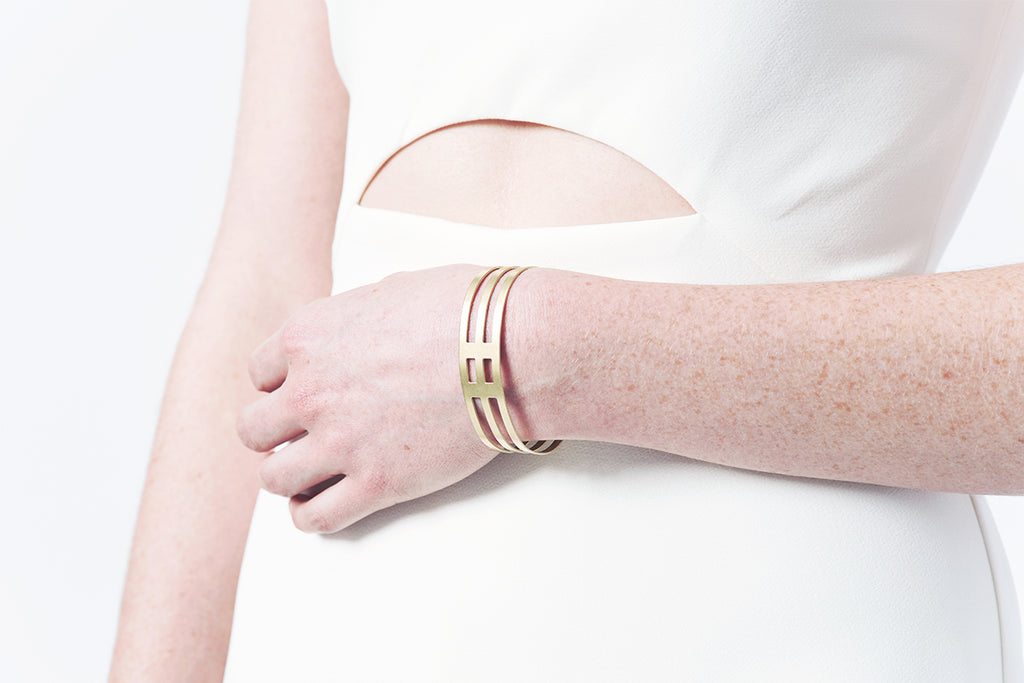 Model wearing jewelry from Stream/Line collection