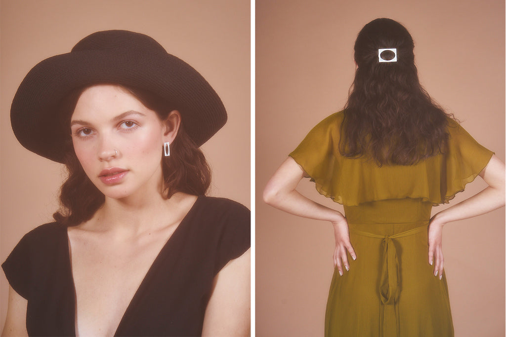 Model wearing Surrounding Space earrings and hairclip