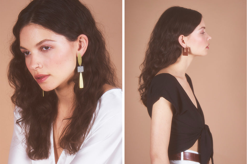 Model wearing earrings from the Surrounding Space collection