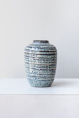 Striped blue and white glazed small Toku vase by Homart on a white surface in a white room