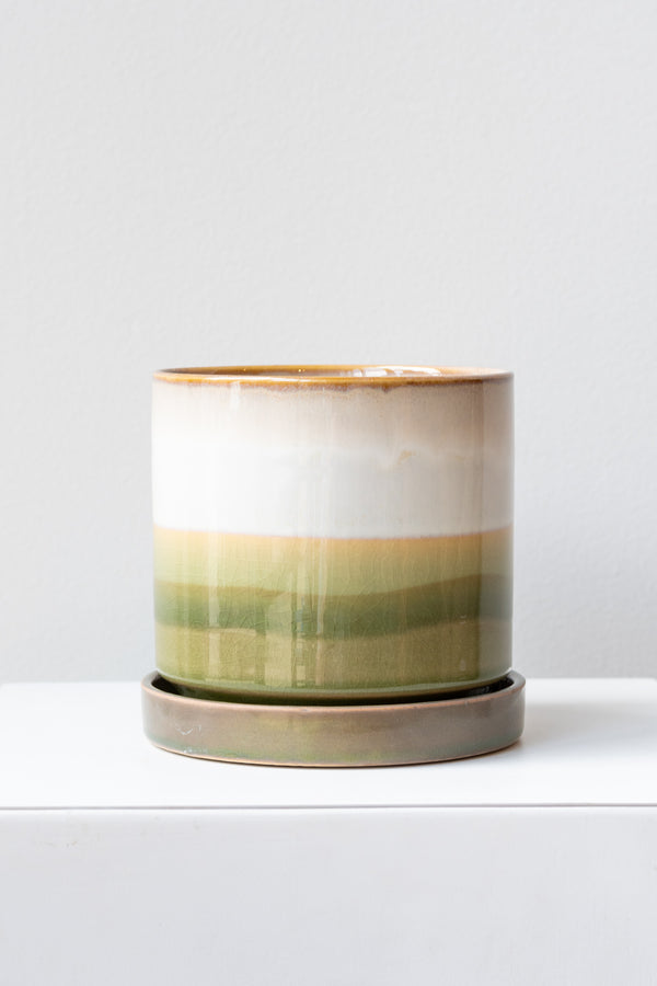 Large Green Layers Minute Pot sits on a white surface in a white room