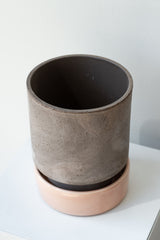 Grey and quartz 5.5 inch Hoff Pot by Bergs Potter on a white surface in a white room