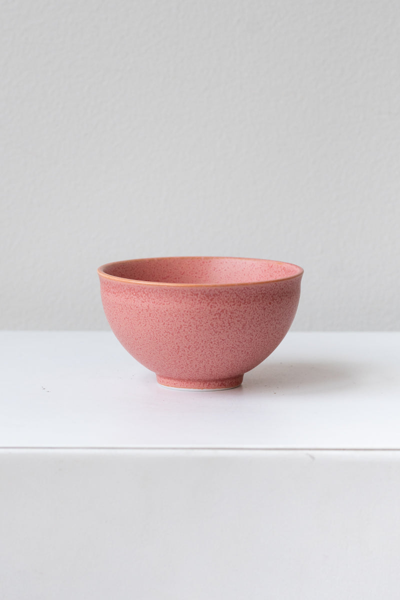 Hot pink ishi teacup by Miya Company Inc sits on a white surface in a white room