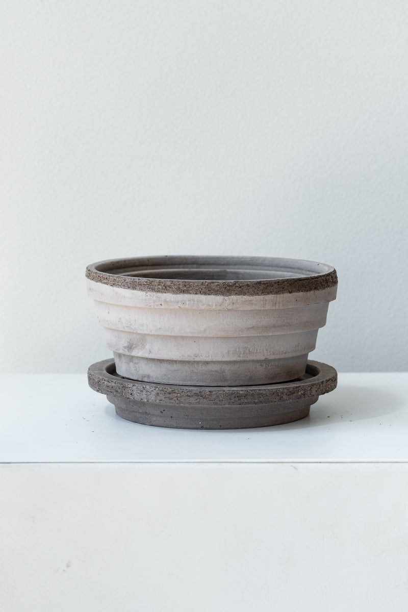 Grey 4.7 inch Planets Pot by Bergs Potter on a white surface in a white room