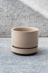 Beige stoneware planter with matching saucer by LBE Designs
