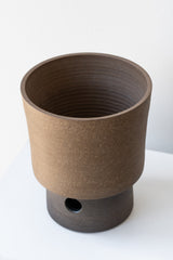 Brown raw clay planter and tray by Horizon Line Ceramics on a white surface in a white room