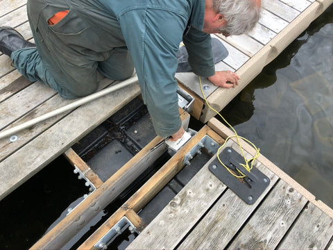 Dock builder installing the complete hitchinge onto an existing dock.