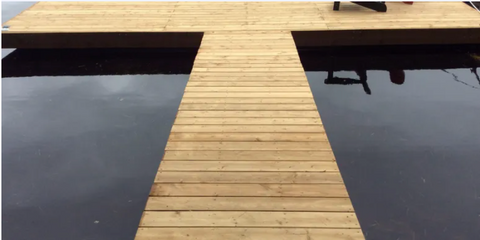New dock in a T shape, with complete hitchinge attaching the top dock to the long dock. In the water.