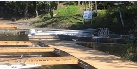 Georgian Bay Marina In Ontario uses the HitcHinge dock coupler system and their marina is shown in the photo. A long dock with multiple side docks attached using the Hitchinge is showcased.