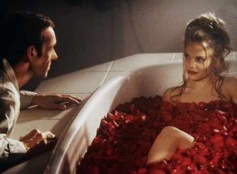 "Scene from the movie ""American beauty"" where the lead actress Mena Survari is in a bath full of rose petals"