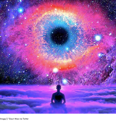 Dramatic purple and blue galaxy with a large eye made out of stars in the background
