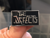 The Defects Enamel Pin