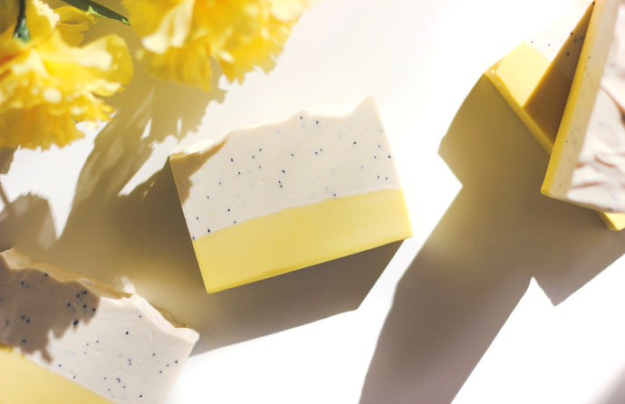 A beautiful photo of a natural soap bar, lemon poppyseed, scented with blend of essential oil and fragrance oil.