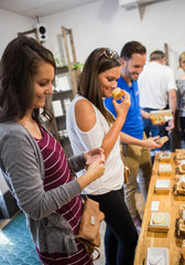 Shoppers in the Glenn Avenue retail store smelling natural soaps