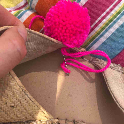 Sew pom poms on to your sandals
