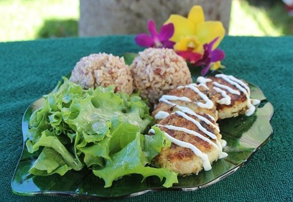 A dish of crab/shrimp tofu patties with a side salad and two scoops of hapa rice.
