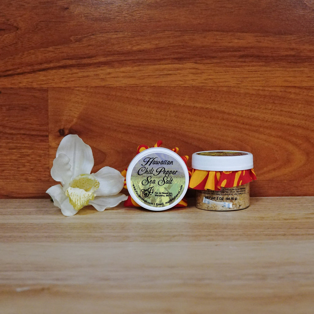 2oz. Hawaiian Chili Pepper Sea Salt on a wooden background.