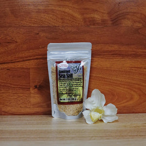 7 oz. Hawaiian Chili Pepper Sea Salt on a wooden background.