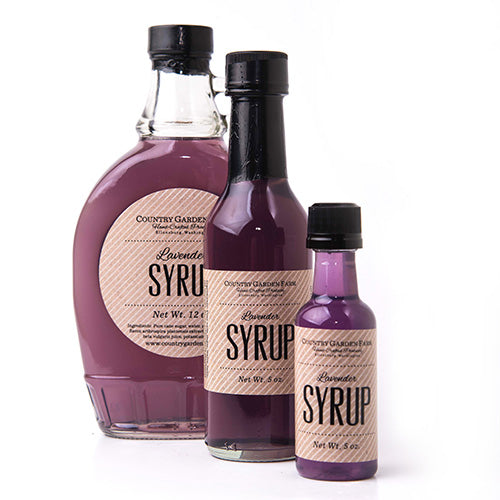 3 clear bottles of various sized bottles of lavender syrup
