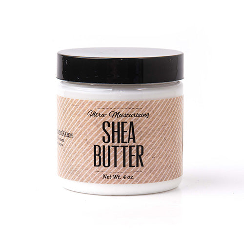 Clear round jar with black screw on top of white shea butter lotion