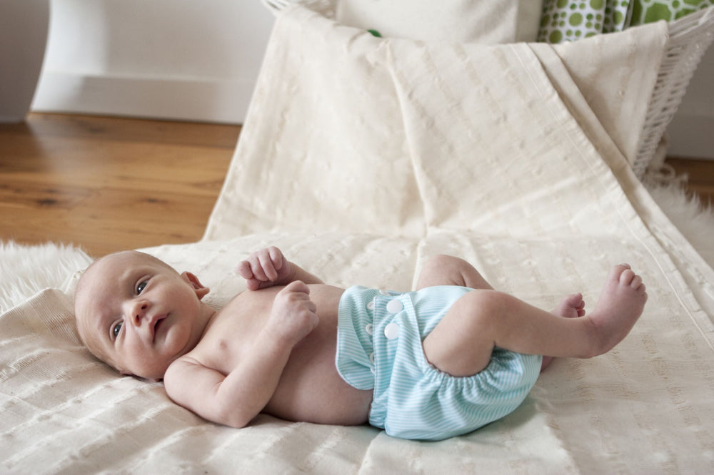 Bambooty newborn easy dry nappy - green stripes in action