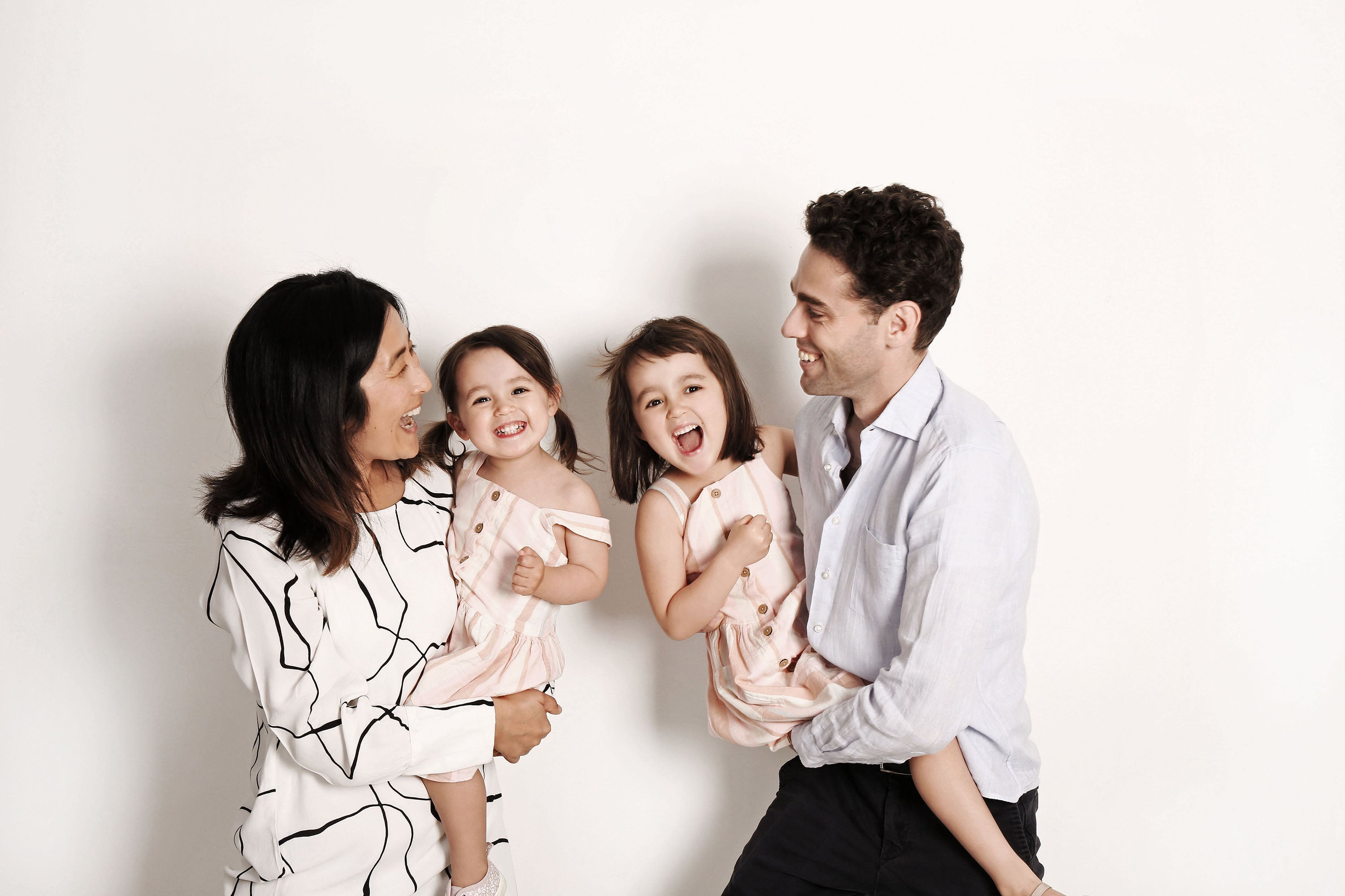 Asian female founder Jennie Gao with her husband and two daughters.