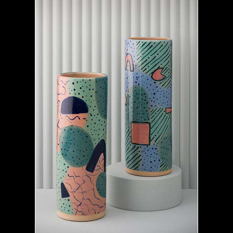 narrow reed relief panel with medium disc and ceramic vases