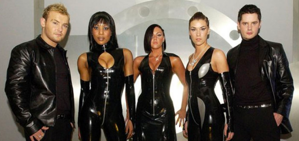 Liberty X Wears Custom House of Harlot Latex Outfits in their 'Just A Little' Music Video