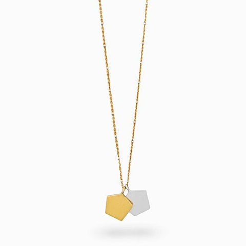 Iza Jewelry Day Dreamer Necklace Gold Vermeil Chain Mixed Metal Sterling Silver for the Classy Tomboy Close Up Pink Background