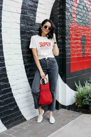 high-waisted denim jeans plus a black or white graphic tee