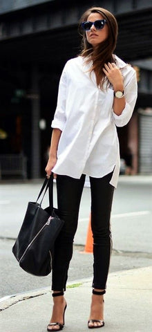 long-sleeved white top paired with black leggings