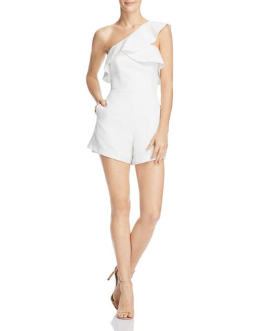 one-shouldered white jumpsuit with ruffles