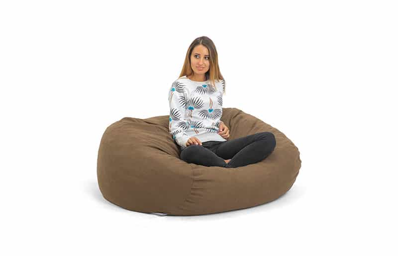 Woman sitting on Rantazy Bean Less Chair RicRac