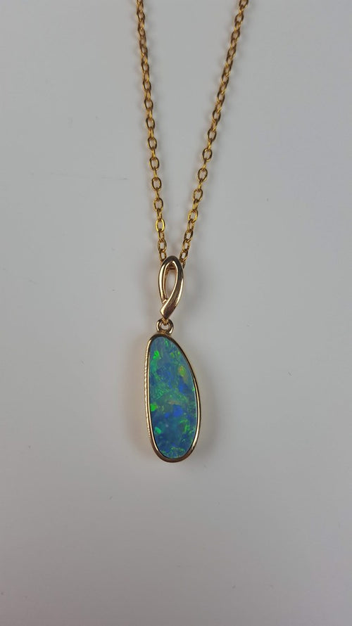Doublet Opal Pendant set in 14K Yellow Gold