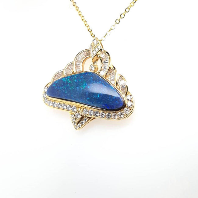 Black Opal Pendant set in 18 Karat Yellow Gold 12.09 carats with 72 x diamonds total 1.81 carats