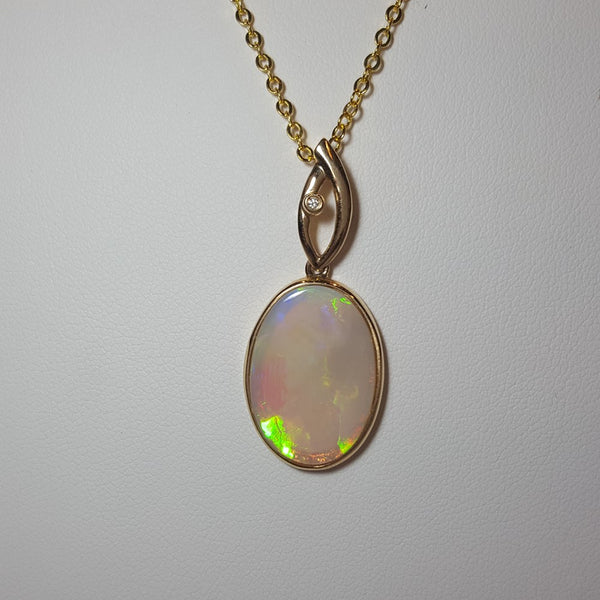White Opal Pendant set in 14K Yellow Gold