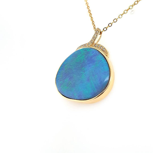 Dark Opal Pendant set in 14 Karat Yellow Gold 25.41 carats with 14 x diamonds