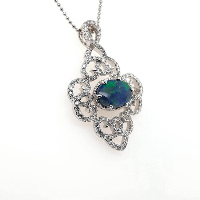 Black Opal Pendant set in 18 Karat White Gold 1.66 carats with 134 x diamonds total 0.74 carats