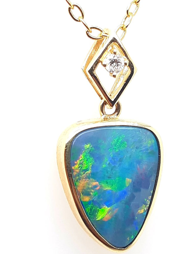 Doublet Opal Pendant 3.50 carat set in 14 Karat Yellow Gold  with 1 x Diamond total 0.04 carat