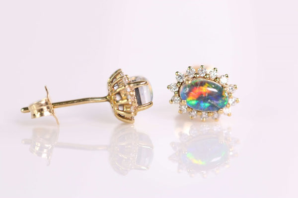 Australian Opal Triplet 6 x 4 mm Earrings set in 9 Karat Yellow Gold with 28 x Diamonds total 0.20 Carat
