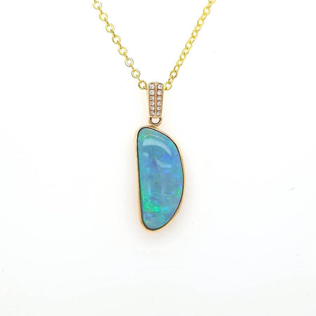 Black Opal 3.1Pendant set in 14K Y GOLD with 1 Di total 0.01ct