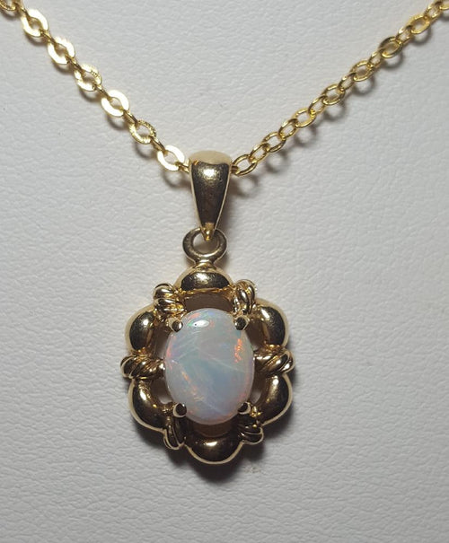 White Opal Pendant set in 14K Yellow Gold     7.5*6mm
