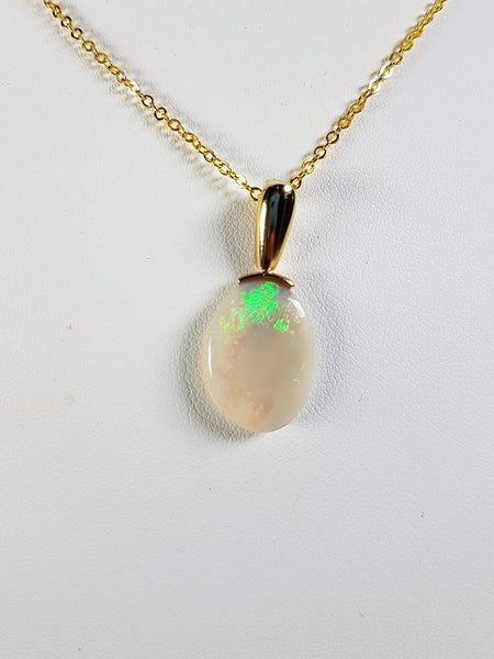 Crystal Opal Pendant set in 14K Yellow Gold 4.5Ct