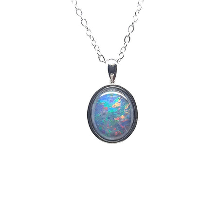 Crystal Opal  9.65ct set in 14K Yellow Gold Pendant with 8 Diamonds TW=0.56ct