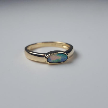 Australian White Opal set in a solid Stainless Steel Ring Setting