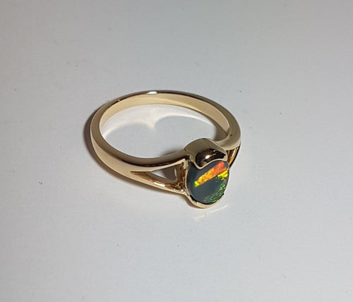 Boulder Opal Ring set in 14K Yellow Gold